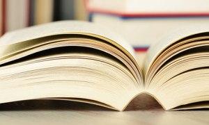 Open novel /book on a table